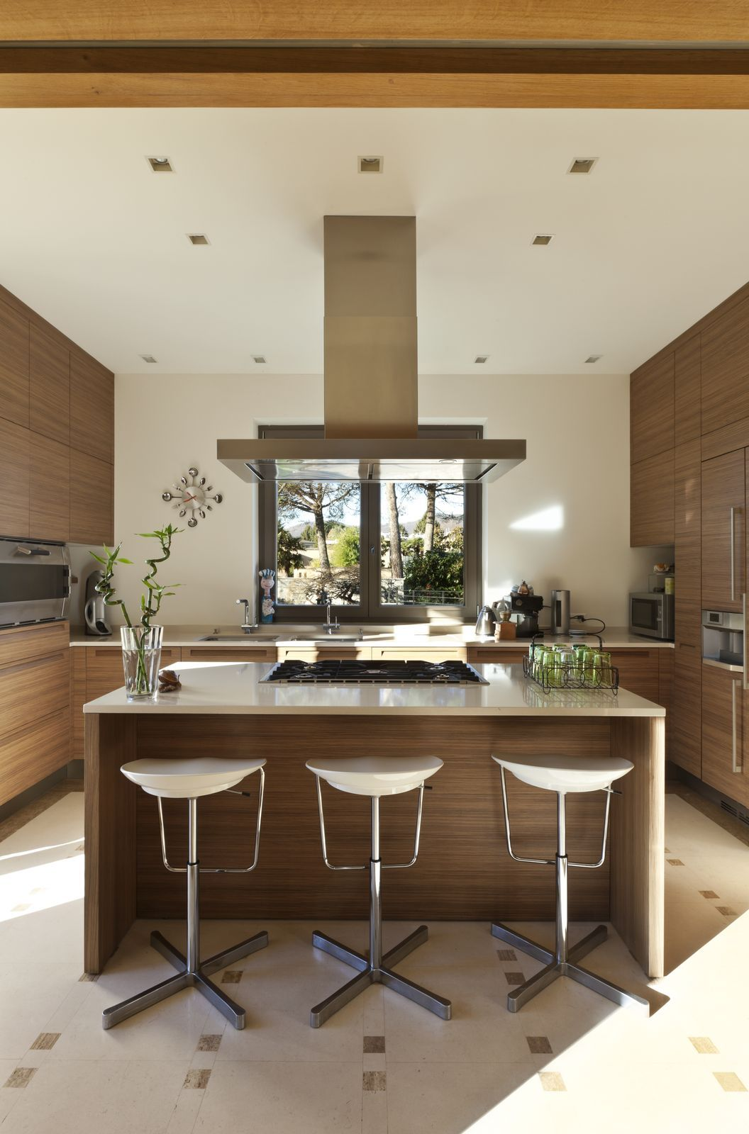 Modern Brown and White Bistro Style Kitchen with Bar seating