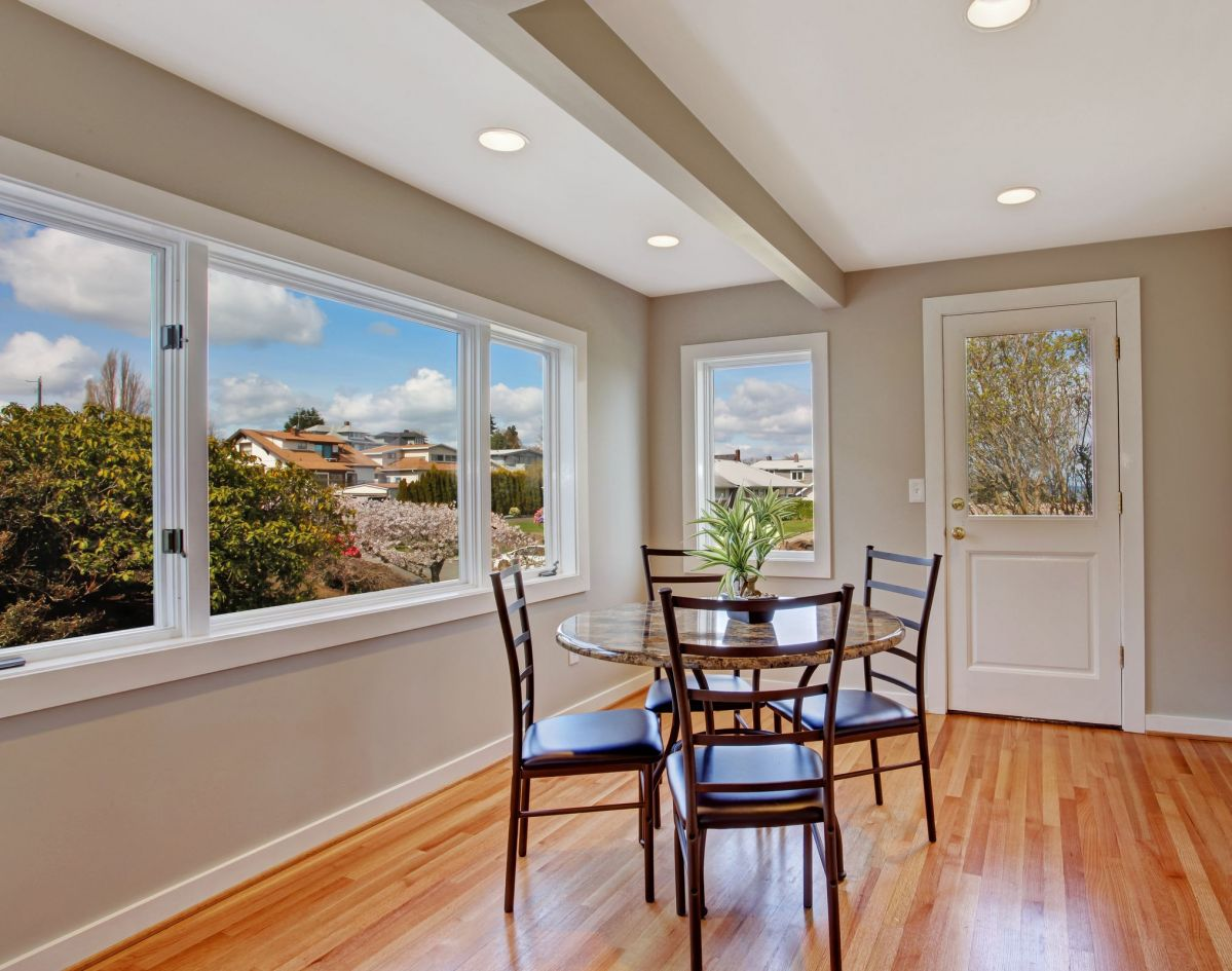 Open Dining Room Windows and Hardwood Flooring
