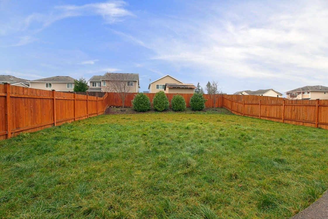 A beautiful yard and neighbor-friendly fence