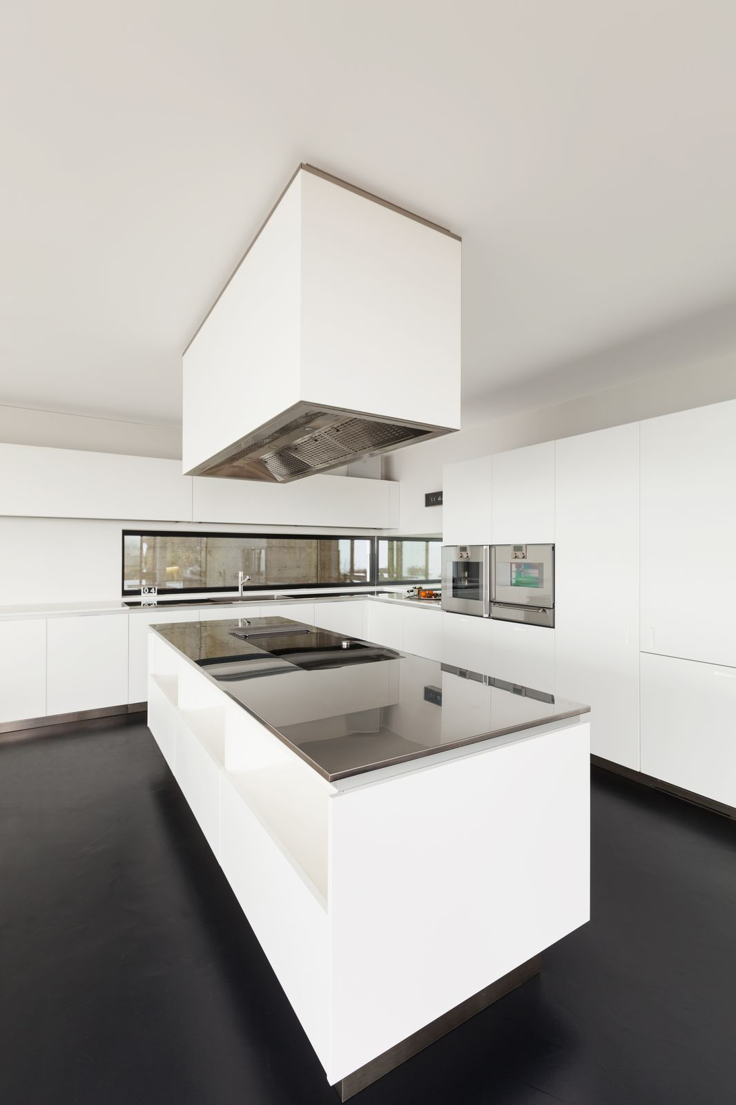 Sleek White New Kitchen Counter Island Fitted with Modern Oven Appliances
