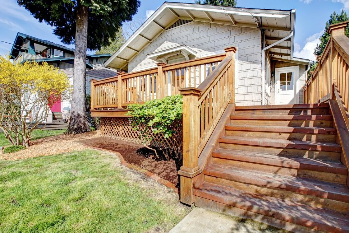Cute home with a welcoming deck and stairs