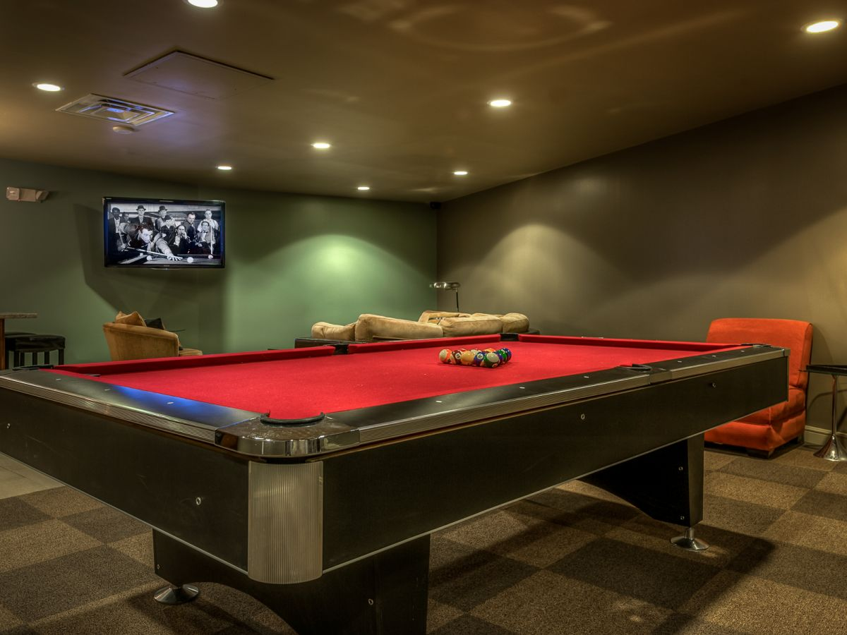 Modern Basement With Dark And Red Pool Table