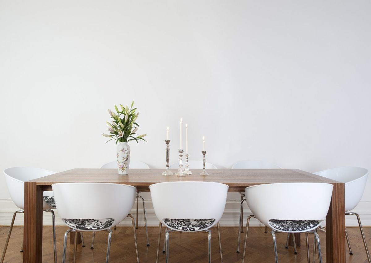 Simple dining set up with beautiful white walls