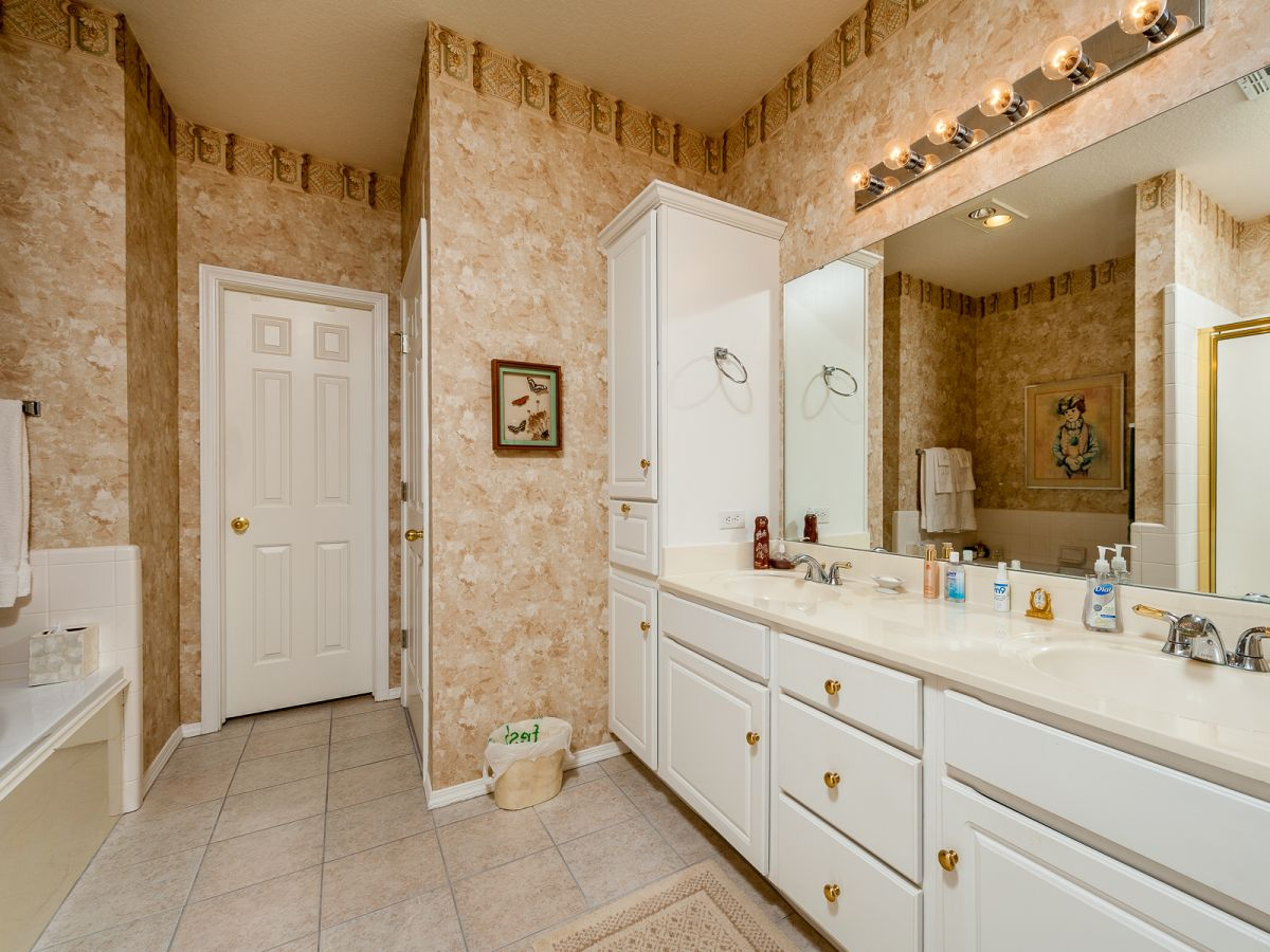 Cork inspired bathroom with white and gold homeyou for Bathroom designs cork