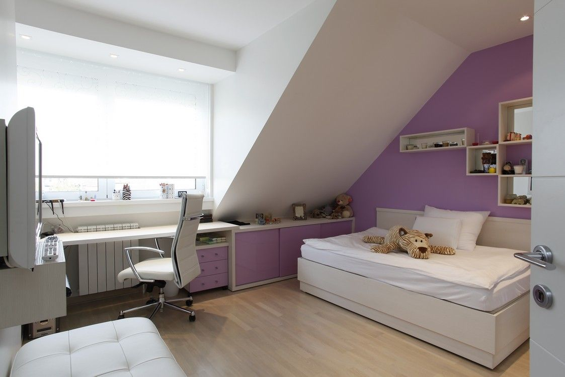 Kid's bedroom with fun purple walls in attic