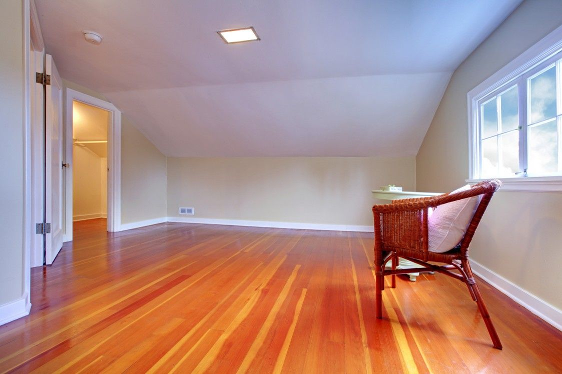 Super-clean attic space with fresh hardwood floors and plenty of light