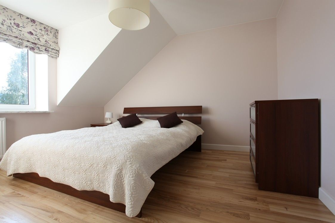 Bedroom in attic with clean, understated style