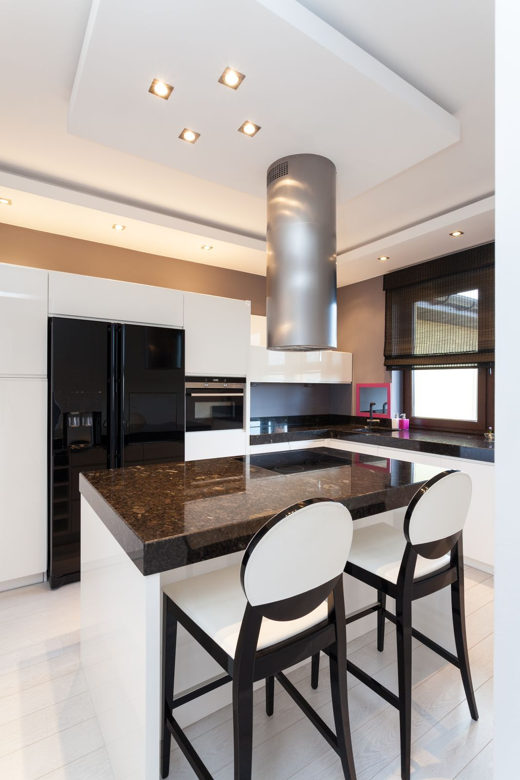 Slender, Sleek Design for a Kitchen with Natural Stone Countertops