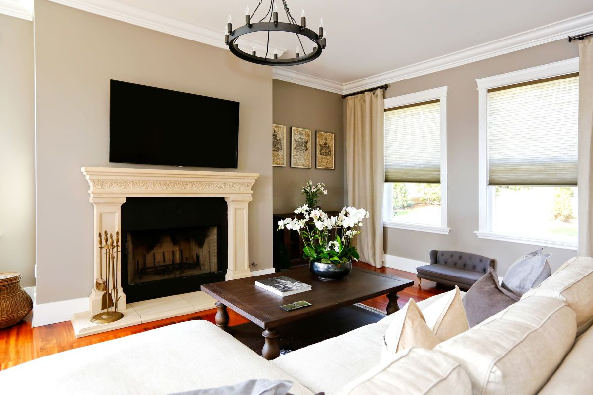 Grand White Fireplace In A Living Room Homeyou