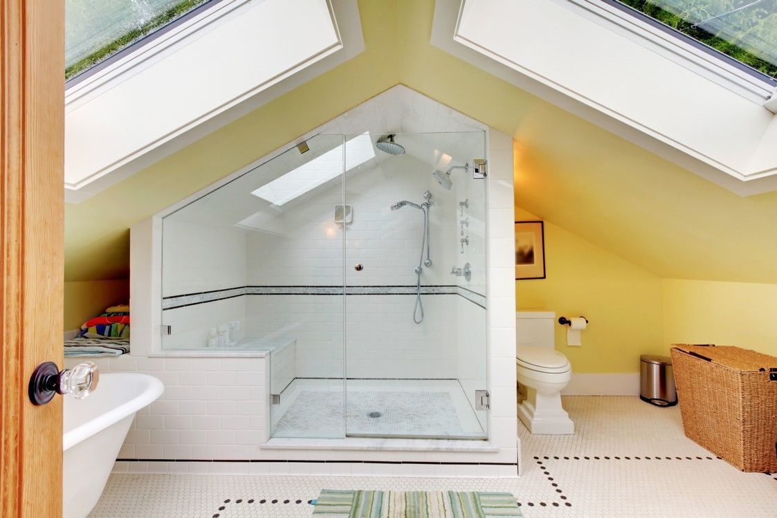 Full bathroom in attic with large skylights
