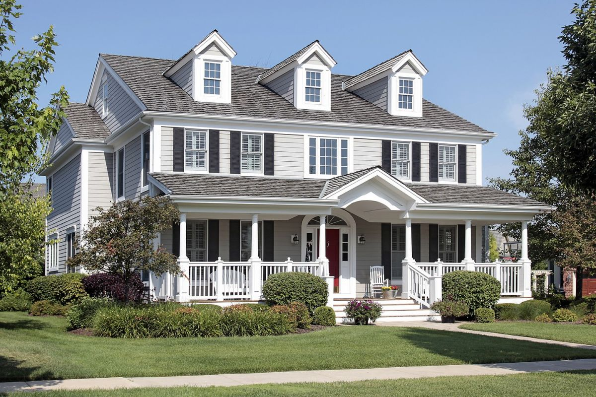 Classic american style house with beautiful front deck for Classic house painting