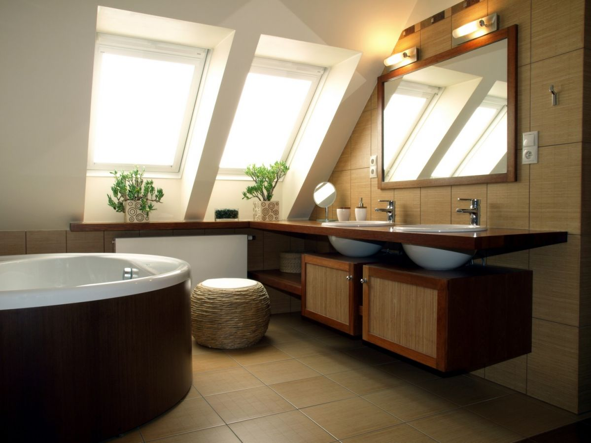 Bathroom in attic with double sinks, jacuzzi and skylights - homeyou