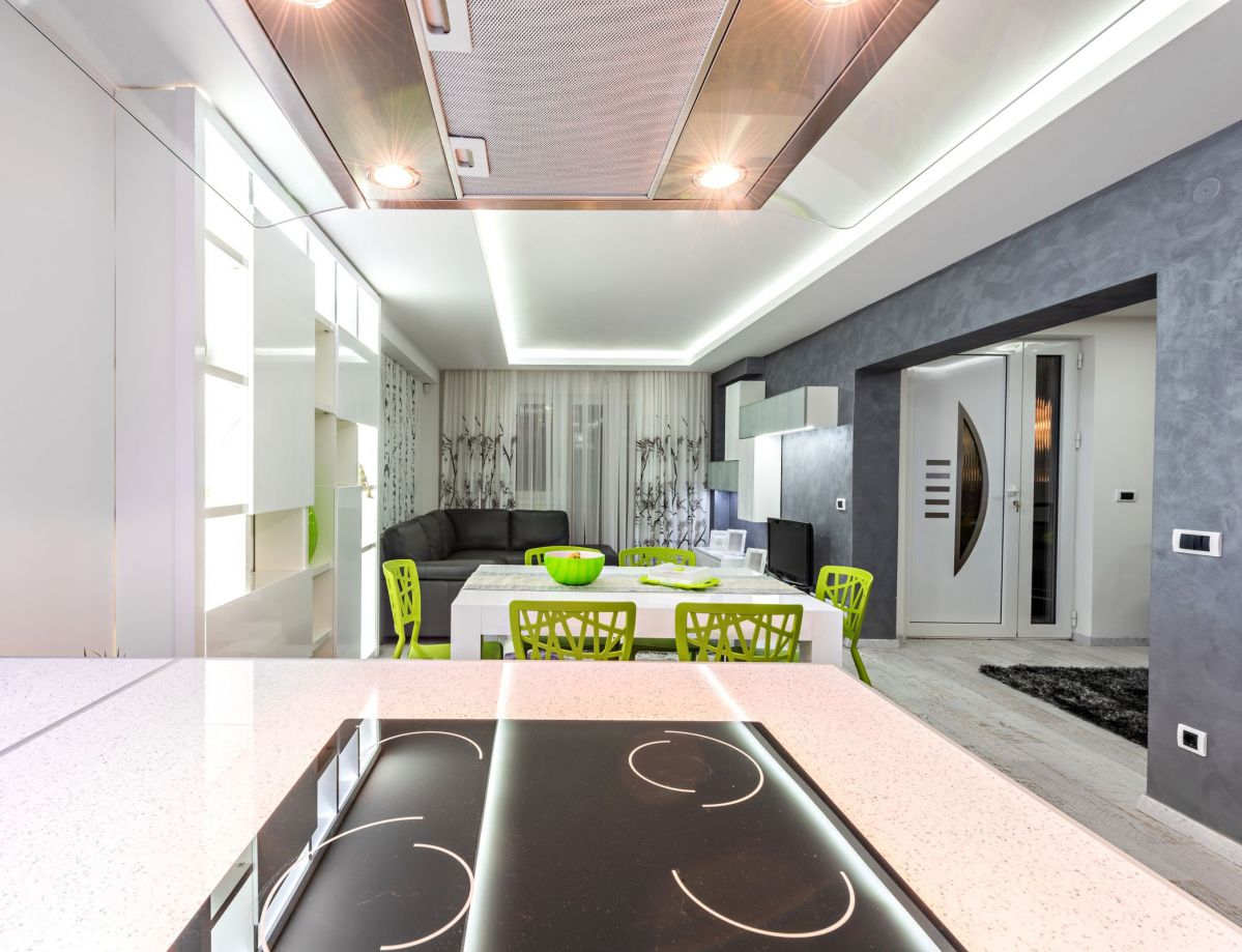 Brilliantly Colored Custom Modern Kitchen with Track LED Lighting and Neon Green Chairs