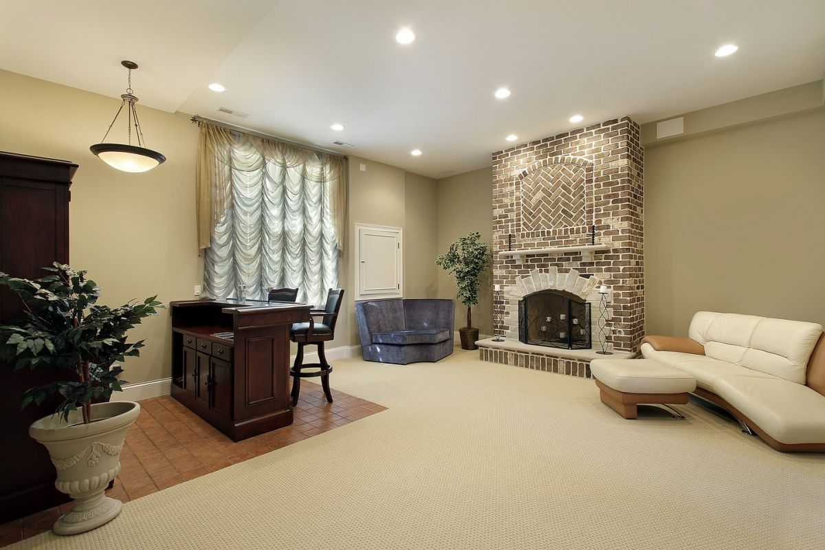 Perfect entertaining space in basement with cozy fireplace