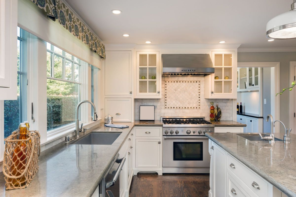 Grey granite countertops modernize this country kitchen for Grey country kitchen
