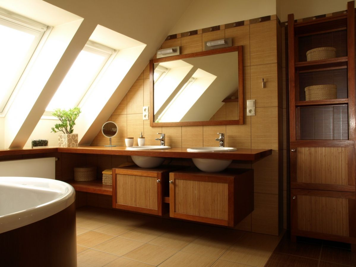 Well-lit bathroom in attic with skylights and tiled floor