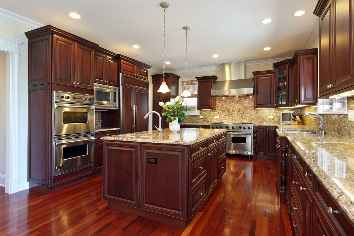Deep dark wood cabinets and floor make for an inspirational kitchen