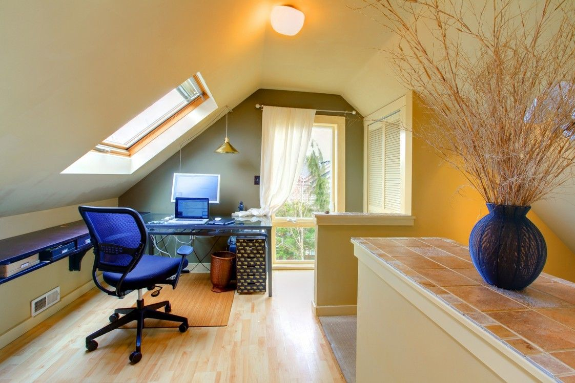 Home office in attic with skylights - a creative space