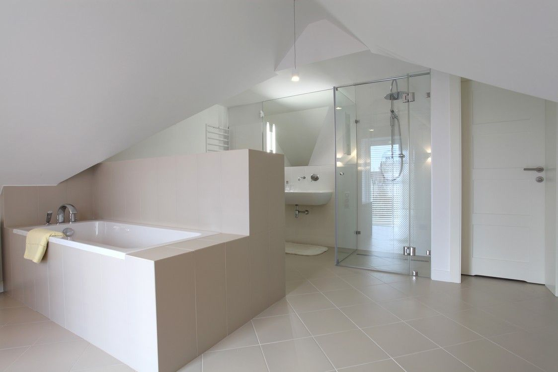 Full modern bathroom in attic with clean, simple style