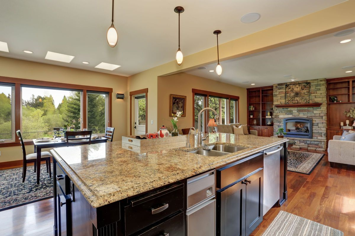 Granite Kitchen Countertops and a Natural Stone Brick Fireplace