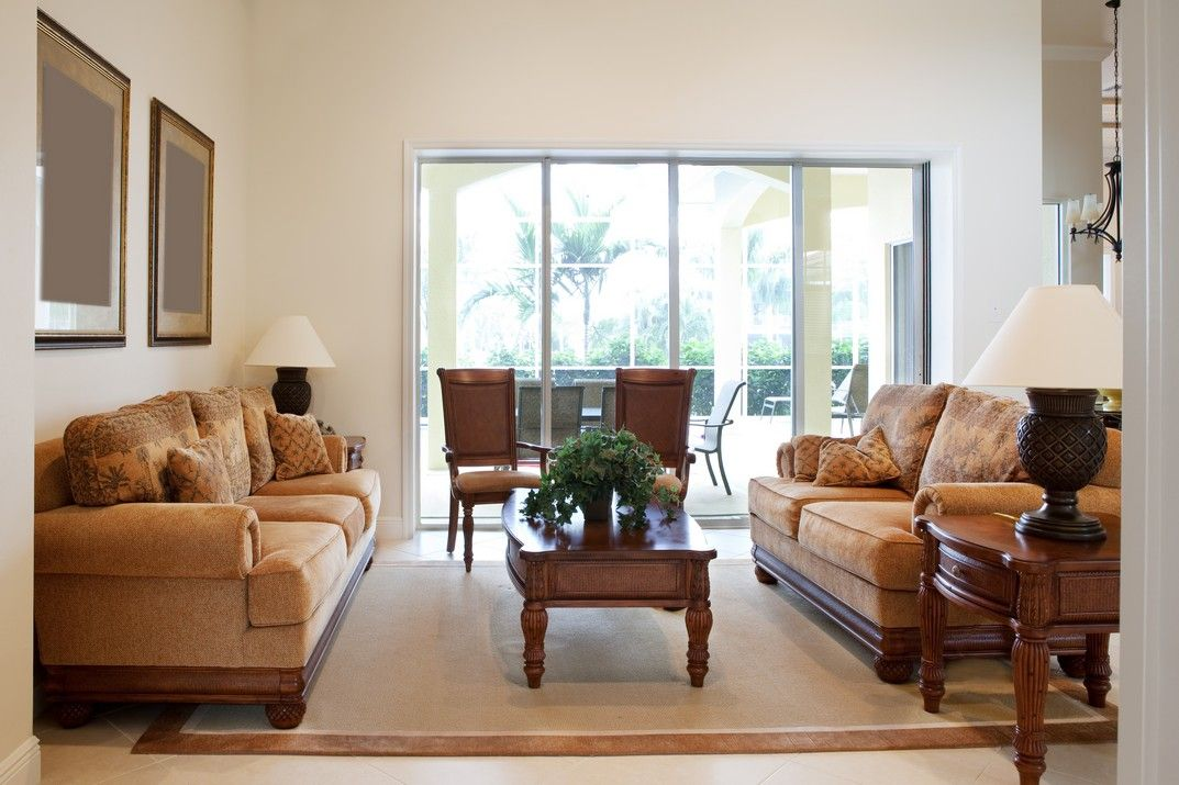 A warm and welcoming living and sunroom area