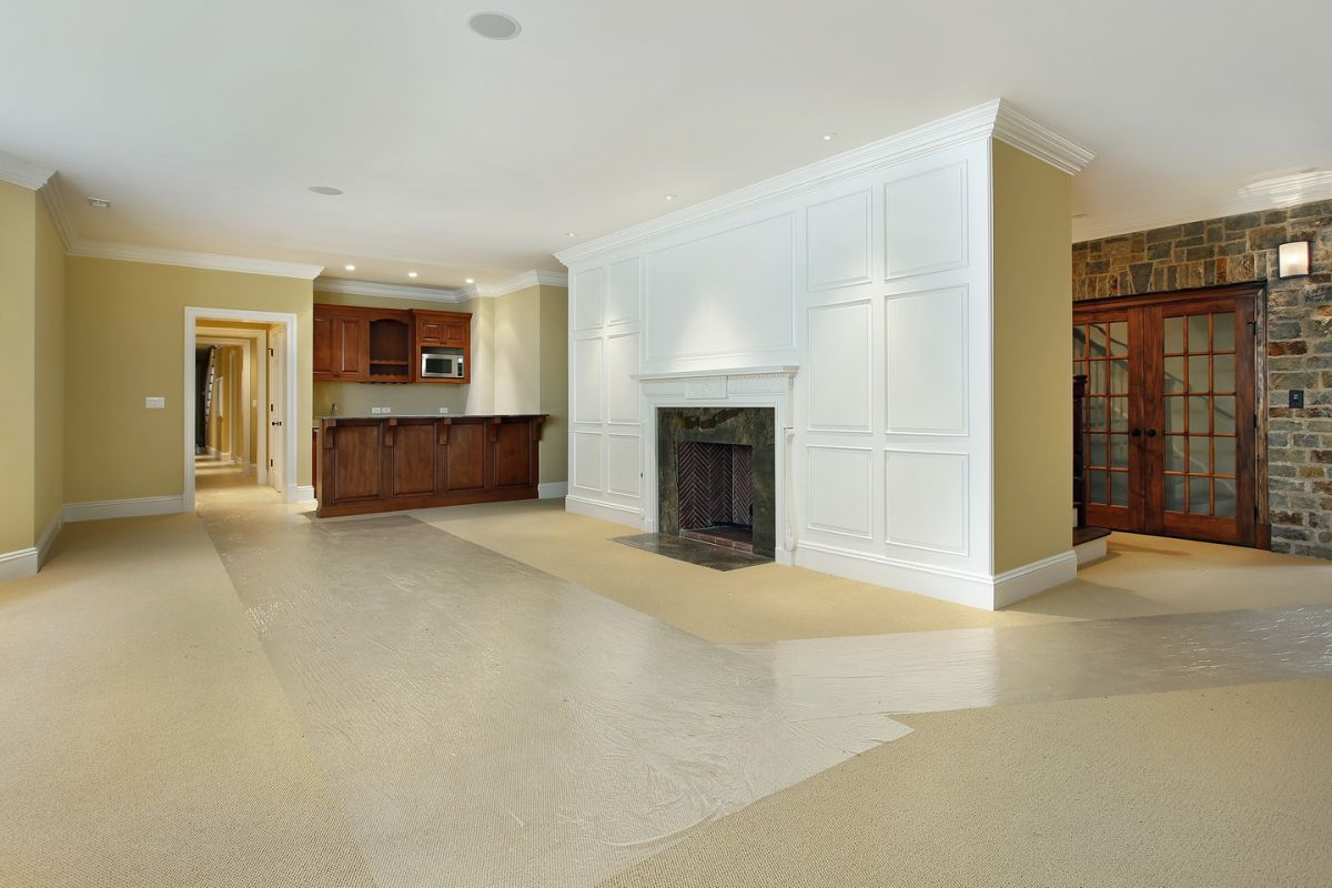 Basement with plenty of room and exposed stone wall and fireplace