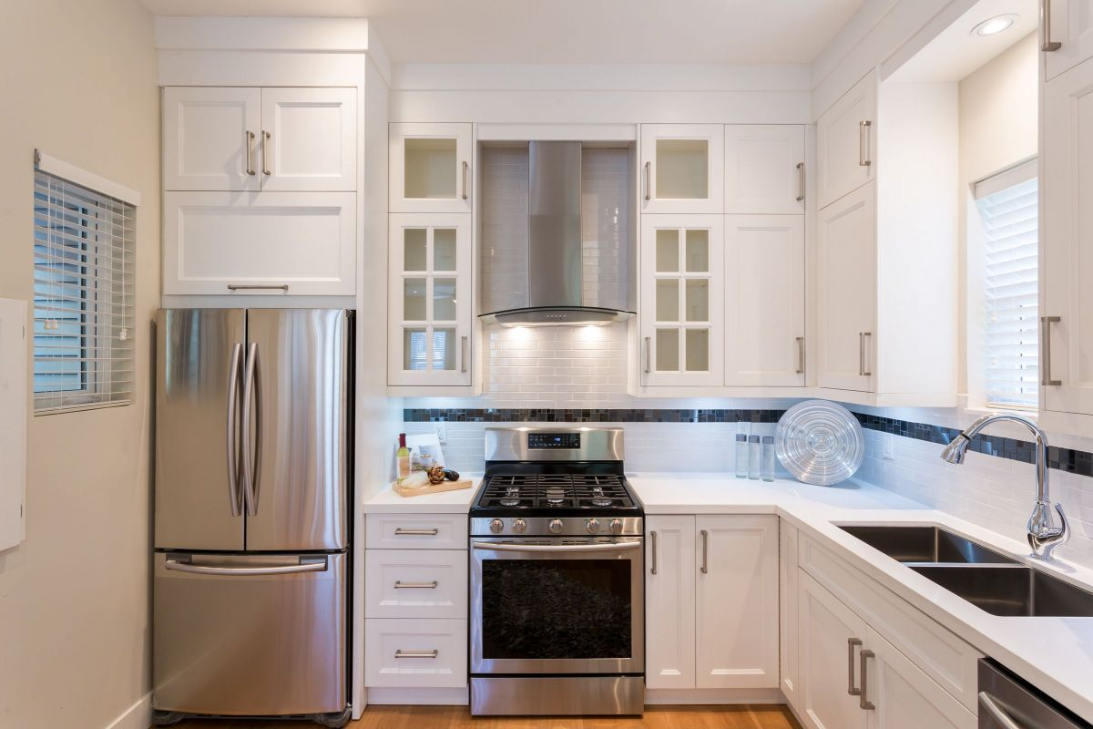 Modernized White Custom Kitchen Cabinets and Silver Hardware