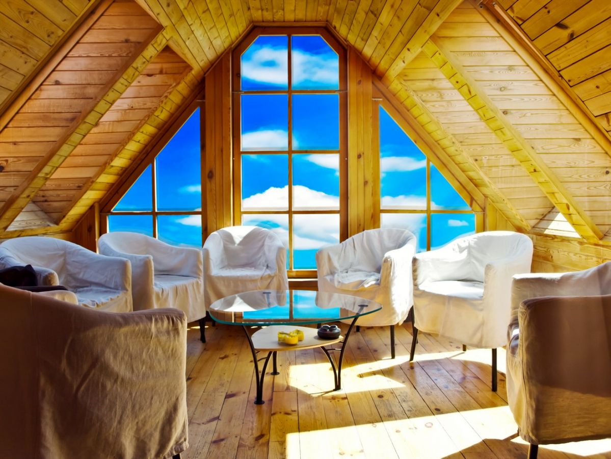 Big windows make this attic an unbelievable sunroom homeyou for Large windows for sunroom