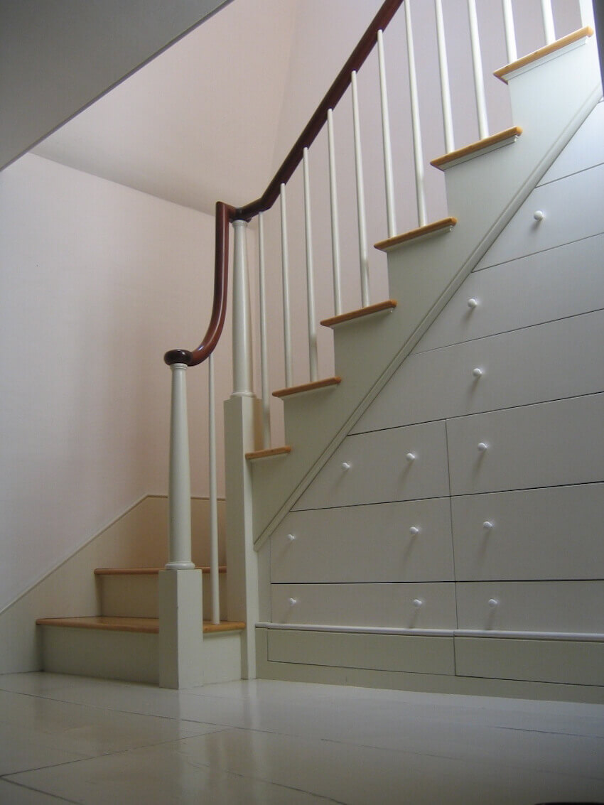 Bookshelves under staircases for the ultimate space saving railings