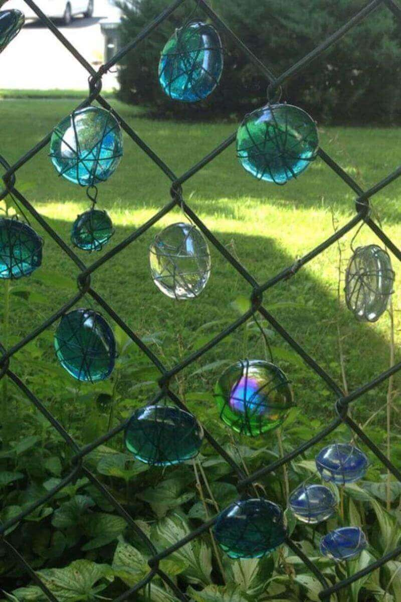 hang glass beads on your chain link fence