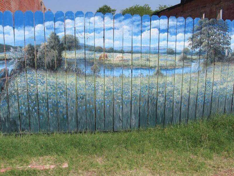 Beautiful beach painted mural on fence