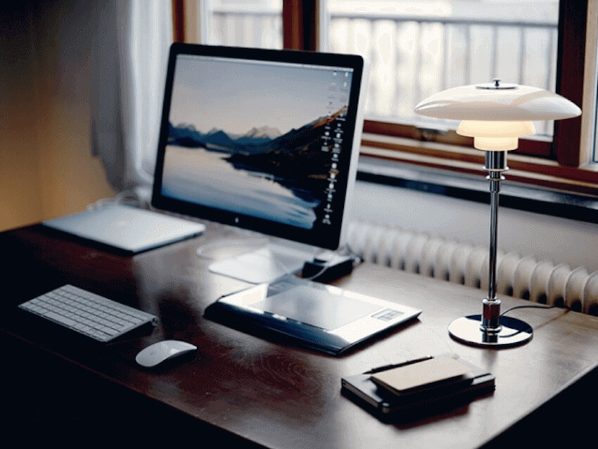 Keeping your home office clutter-free and more in the minimalist style can help you focus more and be more productive.