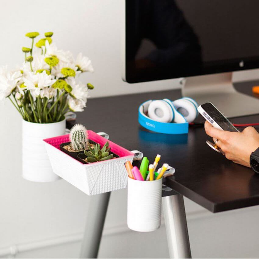 Hang decorative baskets off the edge of your desk to keep clutter of the surface and keep items close at hand.