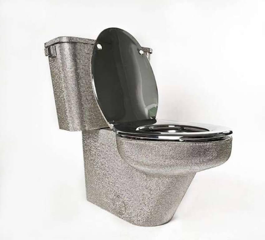 A bathroom toilet that says