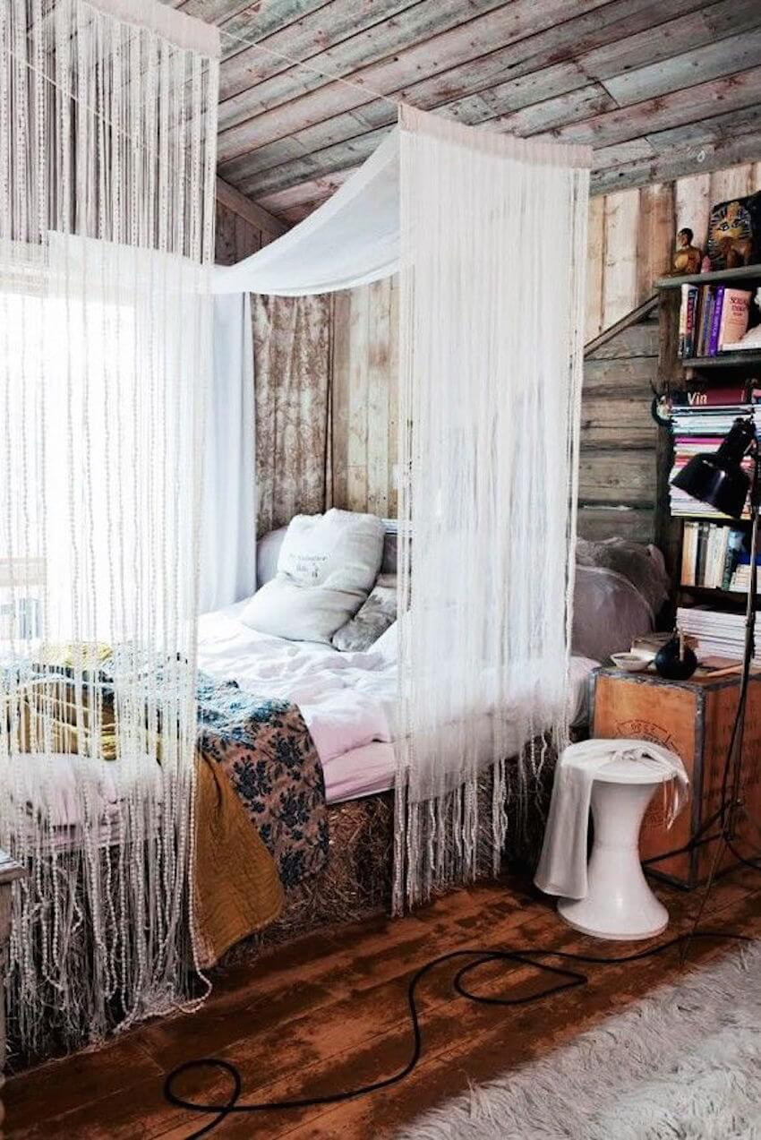 A curtain of white cloth around a bedroom