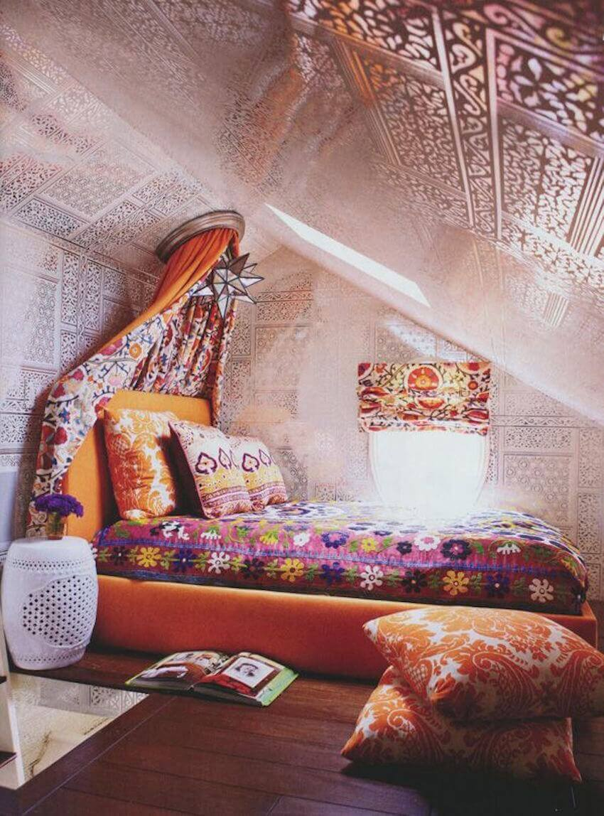 Orange cushions in a boho bedroom life
