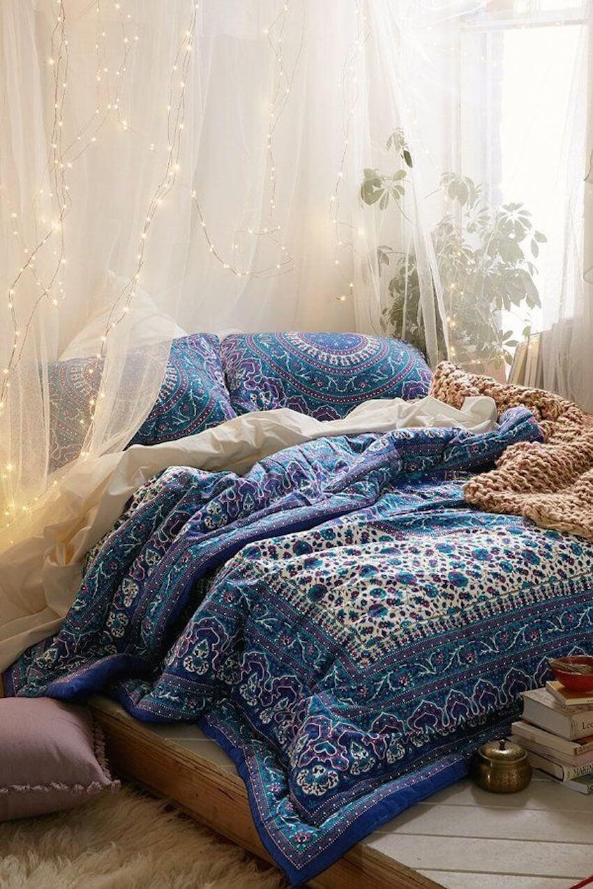 A blue comforter brings a lot of color to the bedroom