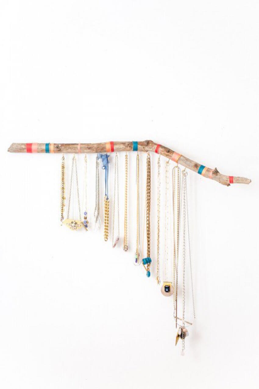 DIY project: To add a touch of nature to your home, use a branch to organize your necklaces and keep them from getting tangled.