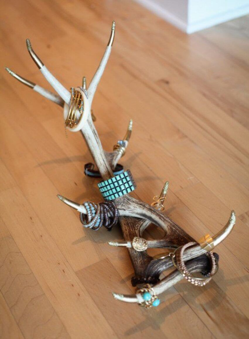 DIY interior decor: Use antlers and paint the tips to make a stunning jewelry display that doubles as a work of art.