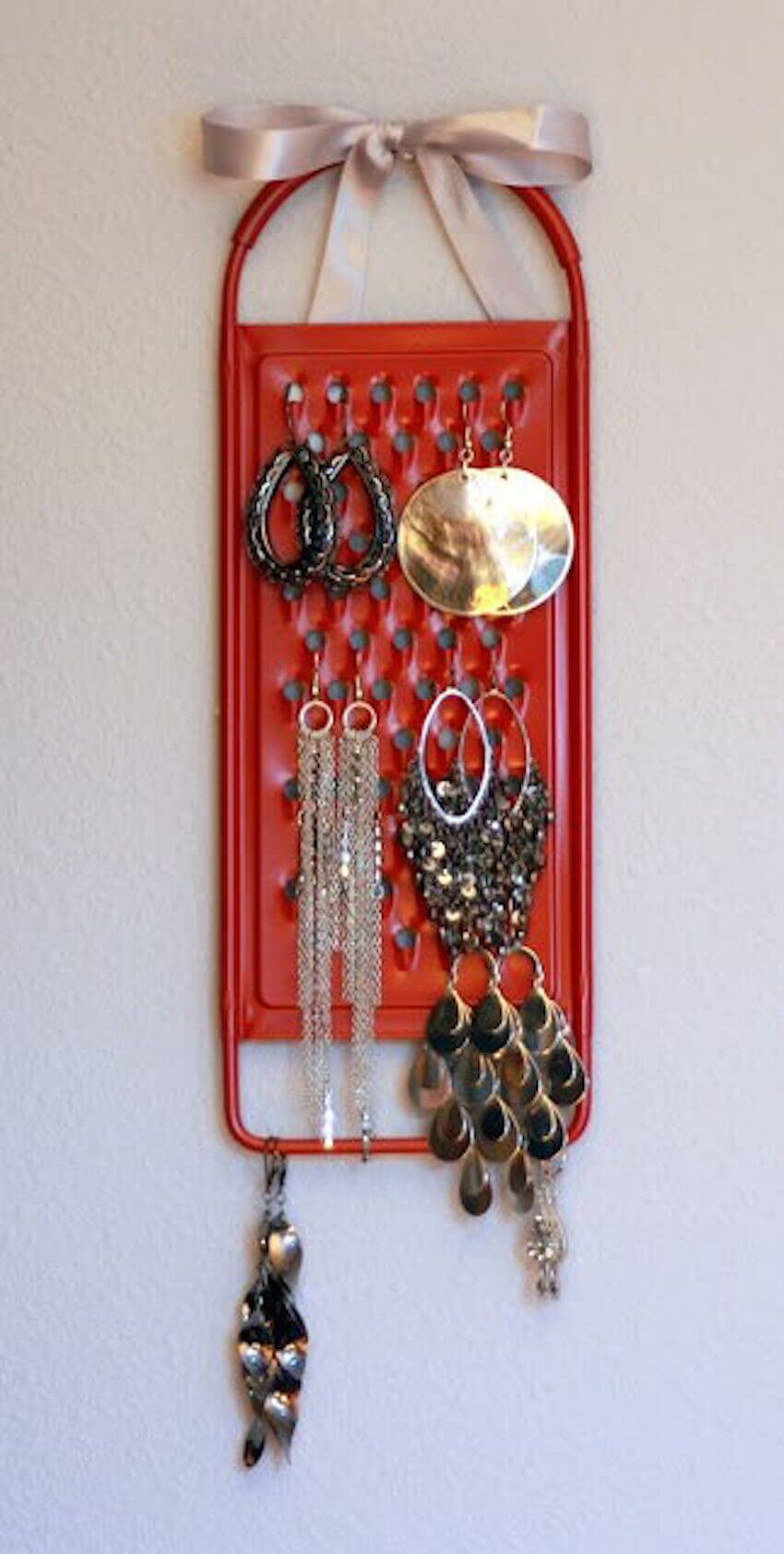 Another DIY: Looking for a way to repurpose that old cheese grater? Use it to organize your jewelry!
