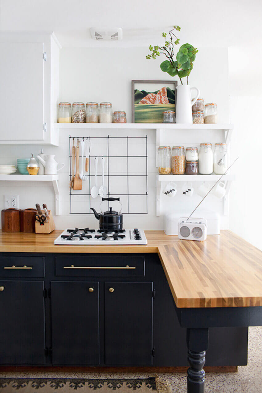 Use a wire grid or pegboard to hang kitchen utensils