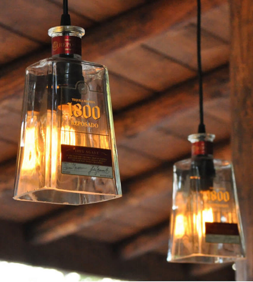 Create medieval lamps out of old bottles