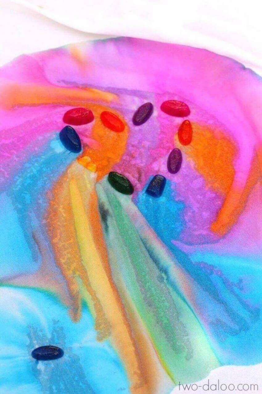 If your kid loves Frozen, this rainbow ice painting project is perfect!