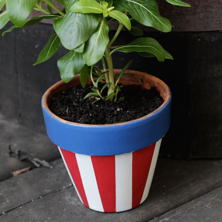 Exterior lawn care:For a quick and easy way to decorate for 4th of July, pick up some basic red, white, and blue paints and decorate your planters!