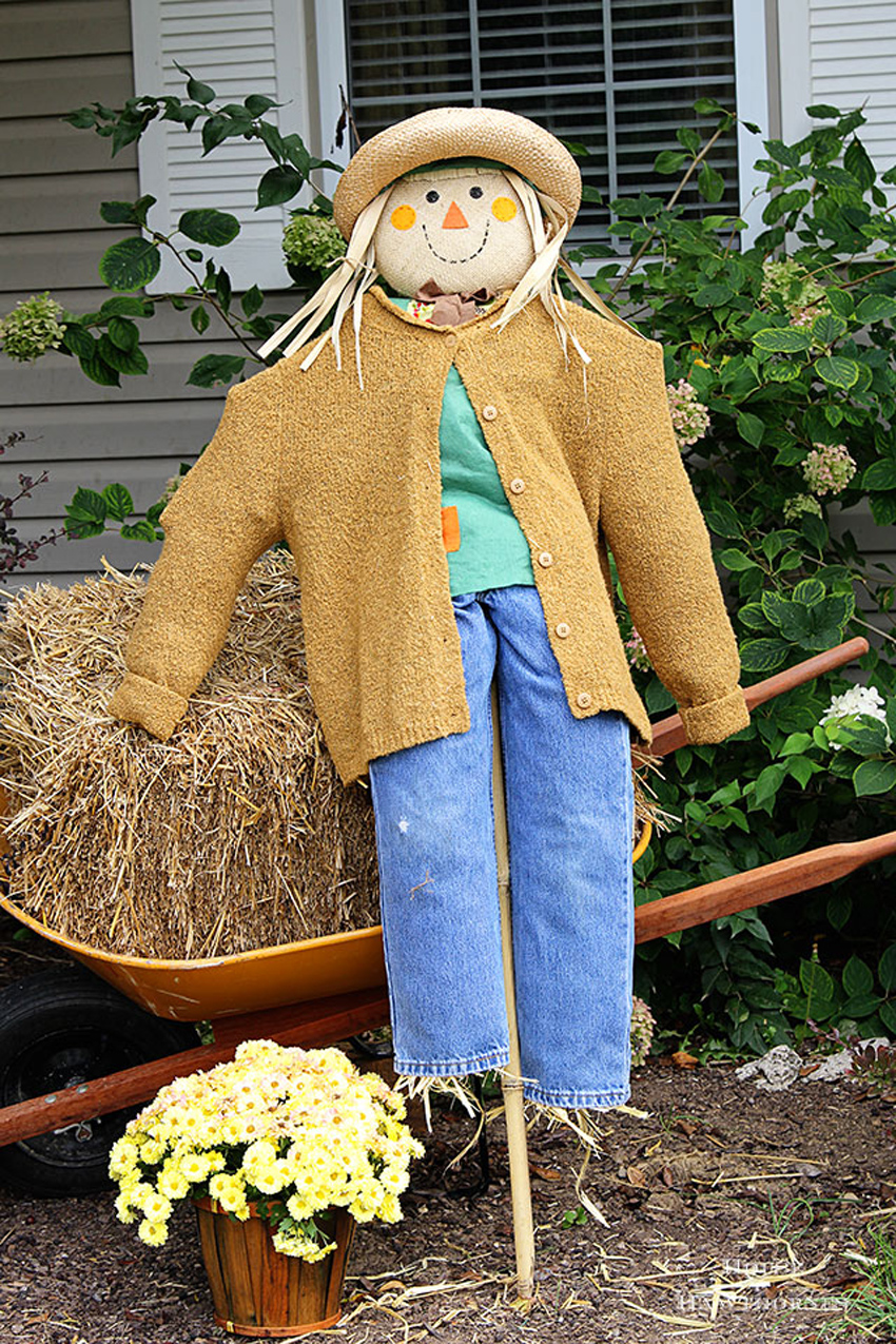 DIY exterior scarecrows are a great way to utilize your autumn leaves.