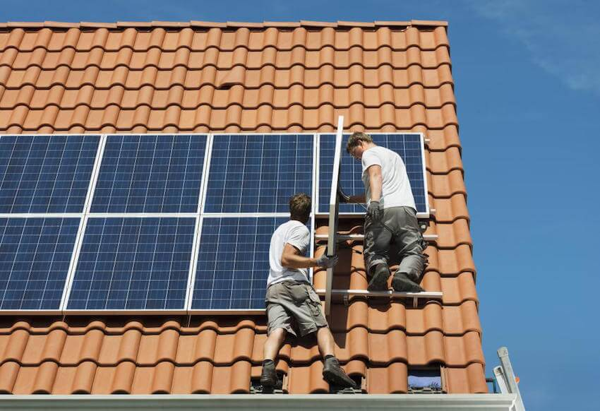 Solar panels being installed on a home