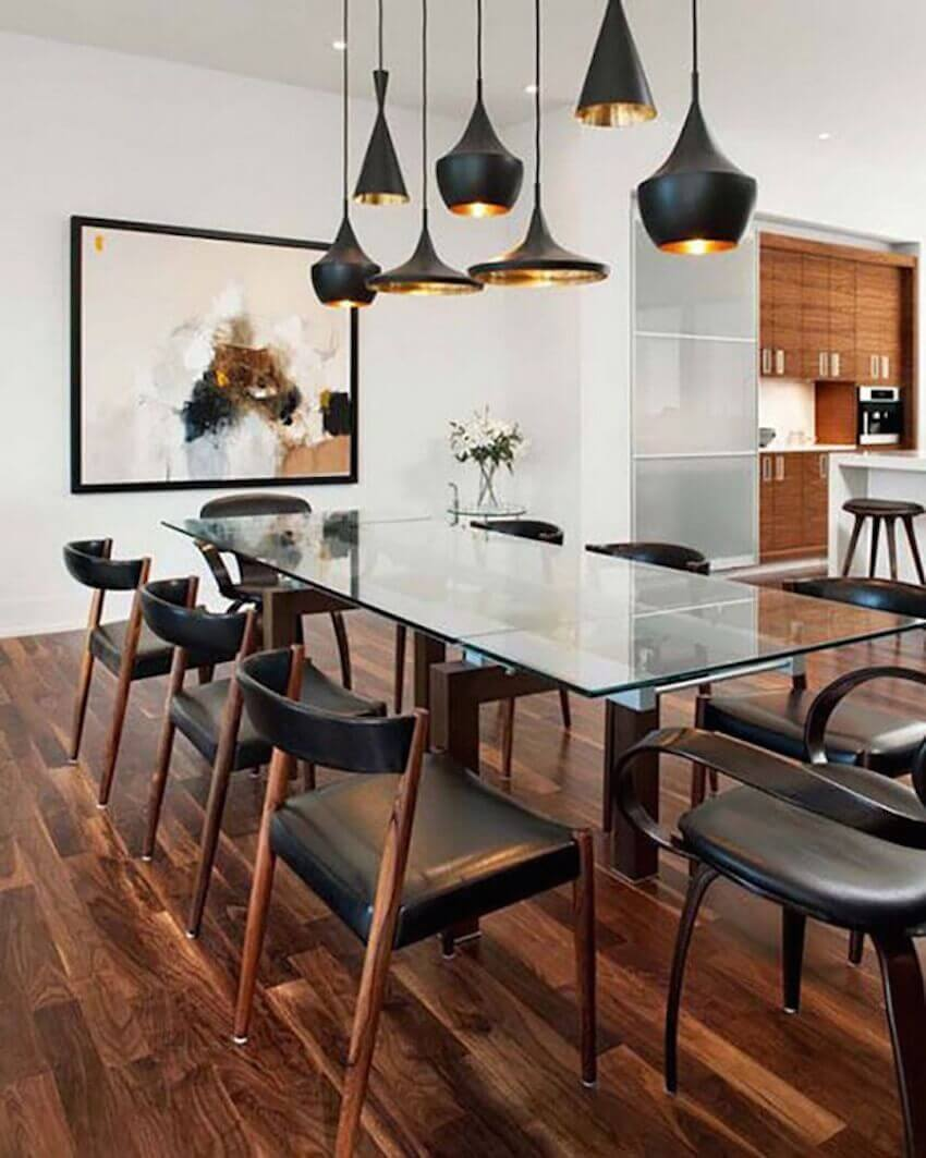 For the mid-centry modern style lovers, using a mix of materials like chrome, leather, wood, and glass will give your dining room a strong and sturdy feel.
