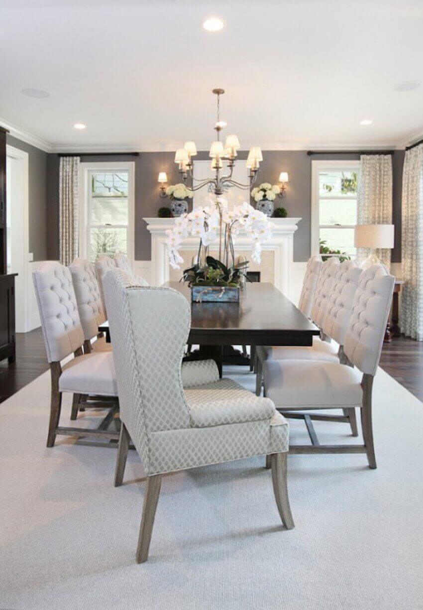 For a classic and elegant dining room, add white trim to your walls and use a classic wood table with quilted chairs.