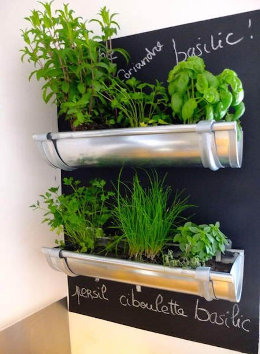 Hanging repurposed gutters herb garden