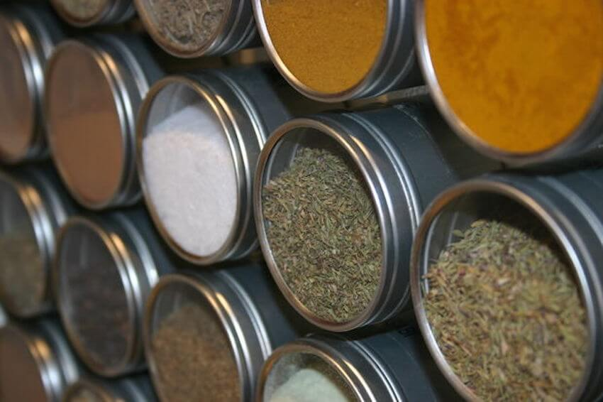 use a spice rack to organize your spices